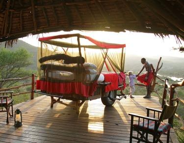 Loisaba-Star-Beds-Star-Bed-Platform-Samburu-Guide-and-Child