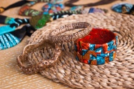 Three handmade ethnic bangles from polymer clay. African jewelry. Fashion background.